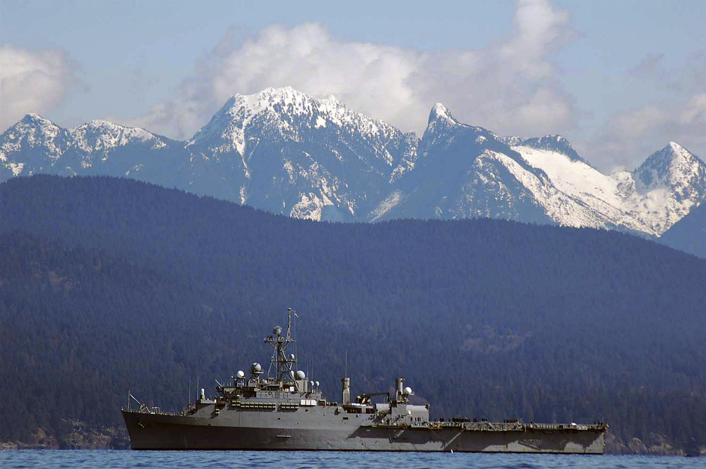 A port side view of the US Navy (USN) Austin Class Amphibious Transport Dock USS CLEVELAND (LPD 7), underway off the coast of Vancouver, Canada during the test of its new torpedo detection system