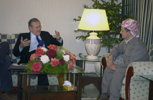 The Honorable Donald H. Rumsfeld, U.S. Secretary of Defense (left) meets with Massoud Barzani, President of the Kurdish Democratic Party, in Salahuddin, Iraq during a meeting with party leaders. Secrertary Rumsfeld is in Iraq to visit with U.S. and coalition forces, and to meet with the newly elected members of the Iraqi government.  (DoD photo by Tech. SGT. Cherie A. Thurlby) (Released)