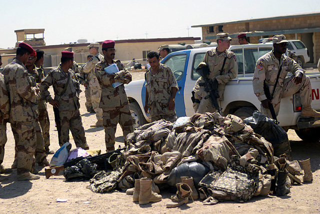 on camp defender a pile of uniforms and gear from iraqi security force commandos voluntarily withdrawing from the iraqi security forces following a mortar