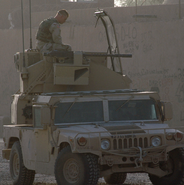 US Army (USA) Private First Class (PFC) Lawrence S. Hughes, Avenger Air Defense Artillery Crewmember, sits atop the Avenger system mounted on the back of an M1037 High-Mobility Multipurpose Wheeled Vehicle (HMMWV) as he waits to head out on a convoy leaving Camp Victory, Iraq, during Operation IRAQI FREEDOM. The Avenger is using its 12.7 mm M3P machine gun on this trip, the Stinger missile pods are removed