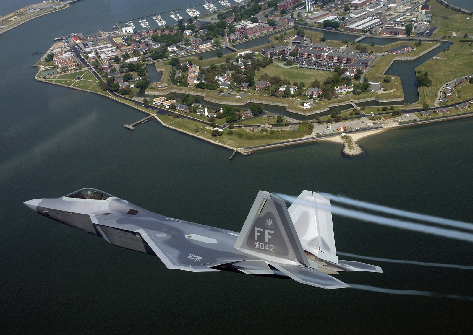 U.S. Air Force LT. COL. James Hecker, Commander, 27th Fighter Squadron, delivers the first operational F/A-22 Raptor to its permanent home at Langley Air Force Base, Va., May 12, 2005.  Tail number 4042 marks the first of 26 Raptors to be deliverd to the 27th Fighter Squadron. (U.S. Air Force photo by TECH SGT. Ben Bloker) (Released)