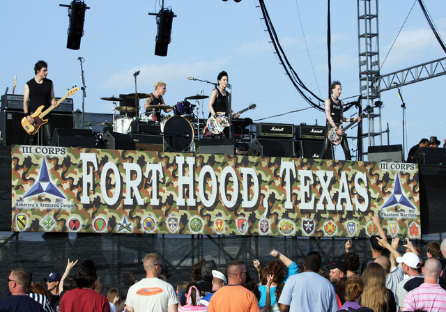 "A large crowd of spectators and onlookers gather to watch as rock music recording artist Joan Jett and the Blackhearts Band performs on stage for the Tribute to Our Heroes"" celebration held at Fort Hood, Texas. The tribute honors US Army (USA) Soldiers who have recently returned from the War on Terrorism, is sponsored by the Morale, Welfare and Recreation (MWR) Department, and will consist of nine hours of live music and entertainment"