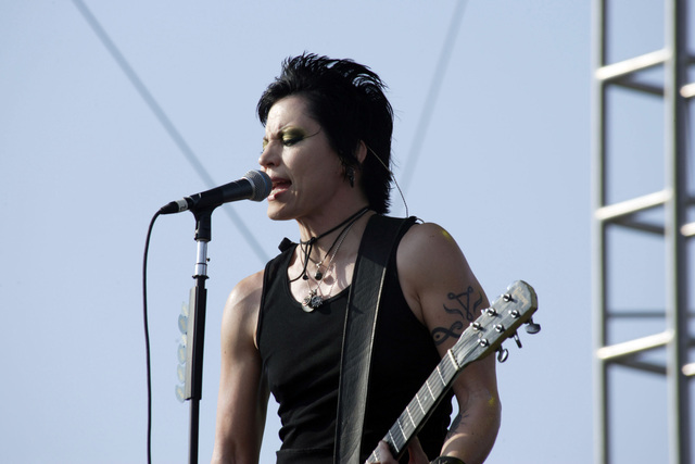 "Rock music recording artist Joan Jett and the Blackhearts Band performs on stage for the Tribute to Our Heroes"" celebration held at Fort Hood, Texas. The tribute honors US Army (USA) Soldiers who have recently returned from the War on Terrorism, is sponsored by the Morale, Welfare and Recreation (MWR) Department, and will consist of nine hours of live music and entertainment"