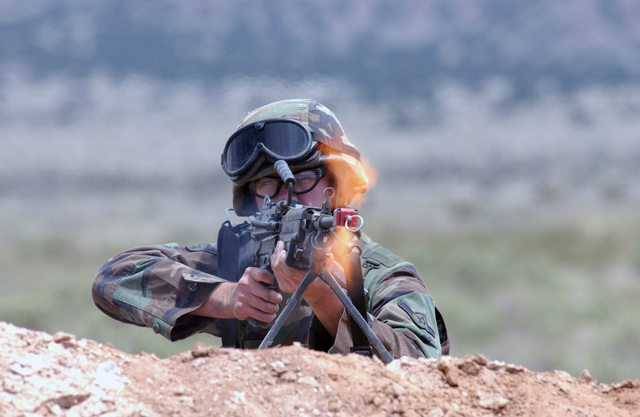"""US Air Force (USAF) AIRMAN (AMN) Morgan Clyde, 377th Security Forces Squadron (SFS), fires an FNMI 7.62 mm M240B machine gun during an attack on the """"Camp Renegade."""" For more than 80 straight hours 132 Airmen from the 377th Air Base Wing (ABW), 58th Special Operations Wing (SOW), Air Force Office of Special Investigation (AFOSI) and Air Force Research Laboratory (AFRL), performed both their specialty and general war-fighting skills in the austere environment of """"Camp Renegade"""" at Kirtland Air Force Base (AFB), New Mexico (NM)"""