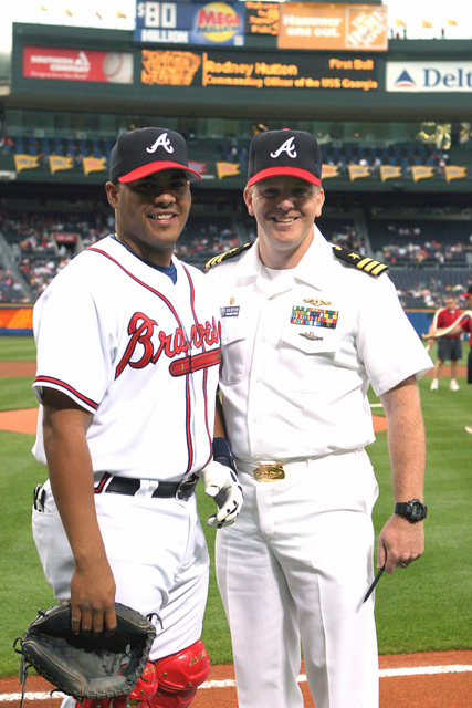 After throwing out the ceremonial first pitch, US Navy (USN) Commander (CDR) Rod Hutton, Commanding Officer (CO), USS GEORGIA (SSGN 729), poses with Atlanta Braves Catcher Brayan Pena at Turner Field at an Atlanta Braves vs. New York Mets Major League Baseball (MLB) game. The ceremony is part of Atlanta Navy Week, a series of community relations events organized by the Navy Office of Community Outreach and Naval Recruiting District Atlanta