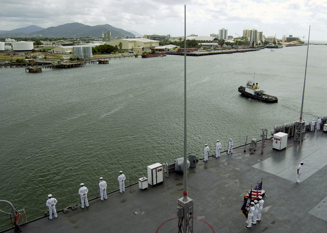 US Navy (USN) Sailors aboard the Seventh Fleet command ship USS BLUE RIDGE (LCC 19) man the rails as the ship arrives at Cairns, Australia (AUS). Approximately 1,000 USN Sailors, US Marine Corps (USMC) Marines, and embarked staff personnel will conduct several community relations projects while in port