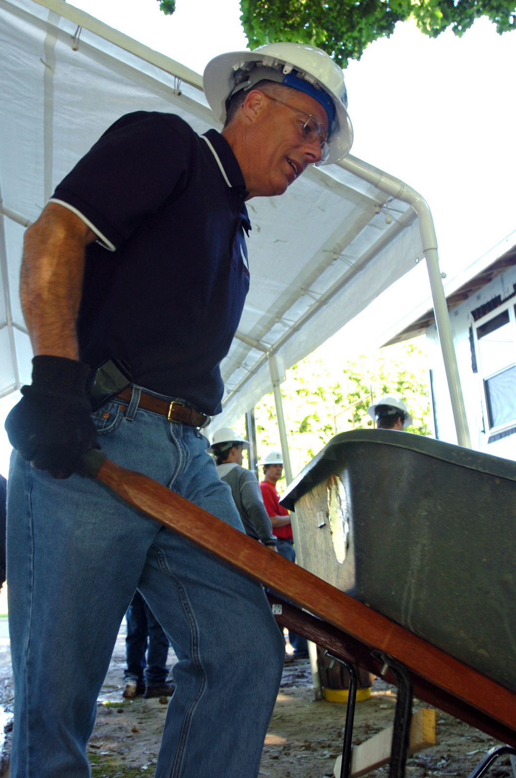 The Adjutant General (AG) of the Michigan Army National Guard (MIARNG) Major General (MGEN) Tomas G. Cutler, helps the State of Michigan employees with a Habitat for Humanity housing project in Lansing, Michigan (MI). (A3596)