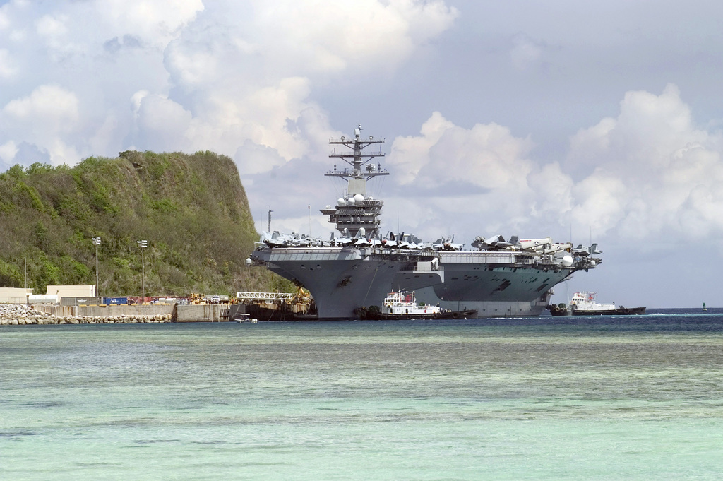 Port view of the US Navy (USN) Aircraft Carrier USS NIMITZ (CVN 68) arriving at Apra Harbor, Guam (GU). The Nimitz Carrier Strike Group is visiting Naval Base Guam (GU) for a scheduled port visit while on a regularly scheduled deployment in support of the Global War on Terrorism