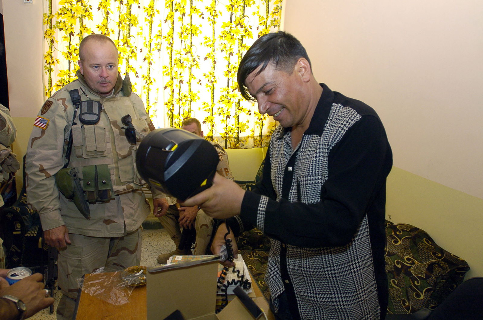 SGT. Anthony Blair from the 940th MP Company out of Walton Kentucky, delevers 9mm ammunation and Spot Lights to an Iraqi Police station during a visit for the purpose of assesing the progress of the Iraqi Police in Dawaniyah on June 21, 2005, Al Dawaniyah, Iraq.(U.S. Army photo by SGT. Arthur Hamilton)(Released)