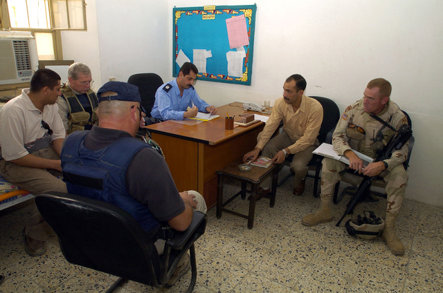 SGT. Ira Turner from the 940th MP Company out of Walton Kentucky, Visits an Iraqi Police station and interviews the Police CHIEF for the purpose of assesing the progress of the Iraqi Police in Dawaniyah on June 21, 2005, Al Dawaniyah, Iraq.(U.S. Army photo by SGT. Arthur Hamilton)(Released)