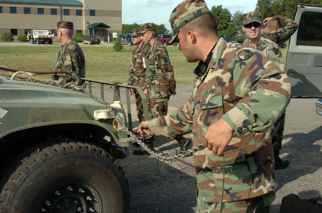 SPECIALIST Marcos L. Vasconcelos of the U.S. Army Reserves 401st Chemical Company, Boston, Mass., prepares a High-Mobility Multipurpose Wheeled Vehicle (HMMWV) for a sling loading training in support of multiple Army Reserve Chemical Companies.  This is one of many activities in support of Operation Red Dragon, a joint civilian-military exercise to test coordinated response to a simulated nuclear and chemical bomb attack at Fort McCoy, Wis., from June 23, 2005 to June 24, 2005.  (U.S. Army photo by STAFF SGT. Brian D. Lehnhardt) (Released)