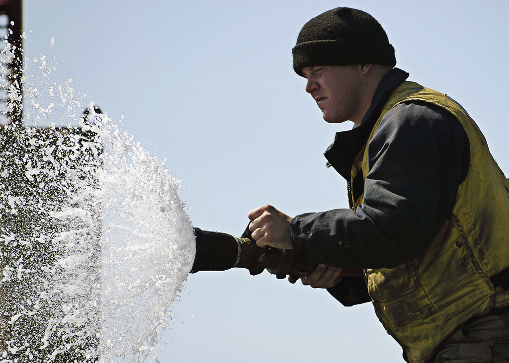 A us navy usn sailor assigned to air department slowly