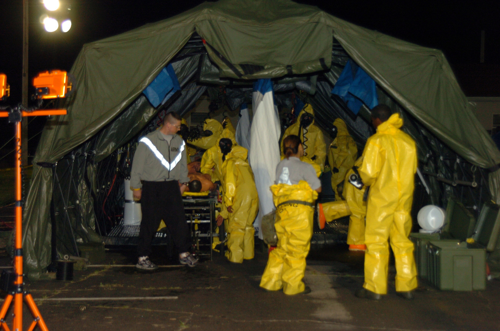 Elements from the Army Reserve 357th, 366th, and 401st Chemical Companies conduct decontamination proceedures for members of their recon companies who just returned from the chemical contaminated area.  This is one of many activities in support of Operation Red Dragon, a joint civilian-military exercise to test coordinated response to a simulated nuclear and chemical bomb attack at Fort McCoy, Wis., from June 23, 2005 to June 24, 2005.  (U.S. Army photo by STAFF SGT. Brian D. Lehnhardt) (Released)
