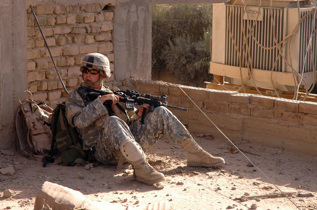 PFC. Brannon L. Cope, a radio operator with the Illinois Army National Guard's 2nd Platoon, 2nd Battalion, 130th Infantry Regiment, takes a much needed rest during a patrol June 23, 2005 in Abu Ghraib, Iraq.  (U.S. Army photo by SPC. Jeremy D. Crisp)