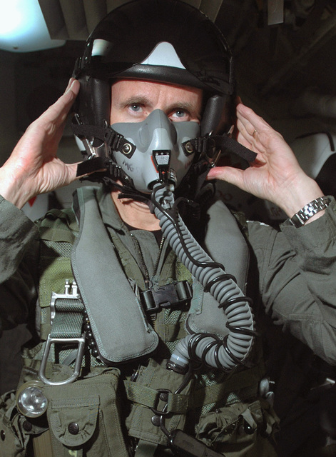 US Navy (USN) Vice Admiral (VADM) Jonathan W. Greenert, Commander, US Seventh Fleet, dons an oxygen mask and pilots helmet as he prepares for a flight in a USN F/A-18F Super Hornet, flown by Strike Fighter Squadron 102 (VFA-102), Naval Air Facility (NAF) Atsugi, Japan (JPN), during his visit to USS KITTY HAWK (CV 63). The KITTY HAWK is currently operating in the Coral Sea in support of Exercise TALISMAN SABRE 2005. TALISMAN SABRE is an exercise jointly sponsored by the US Pacific Command (USPACOM) and Australian Defense Force Joint Operations Command, and designed to train the US 7th Fleet Commander's staff and Australian Joint Operations staff as a designated Combined Task Force (CTF)...