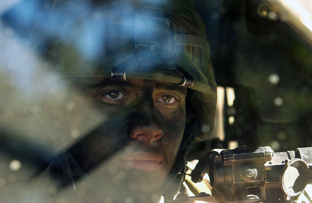 A US Army (USA) Soldier from the 1ST Battalion (BN), 501st Parachute Infantry Regiment (PIR) (1/501), Fort Richardson, Alaska (AK), patrols along a road in a High-Mobility Multipurpose Wheeled Vehicle (HMMWV), during Exercise TALISMAN SABRE 2005. The Australian Defense Force (ADF) and US forces are participating in four weeks of intensive training at Shoalwater Bay, Rockhampton, Townsville and the Coral Sea during Exercise TALISMAN SABRE 2005. More than 6,000 Australian and 11,000 US personnel from the US Navy (USN), USA, US Air Force (USAF), US Marine Corps (USMC) and Special Forces units are participating in this exercise, a merger of the TANDEM THRUST and CROCODILE series of...