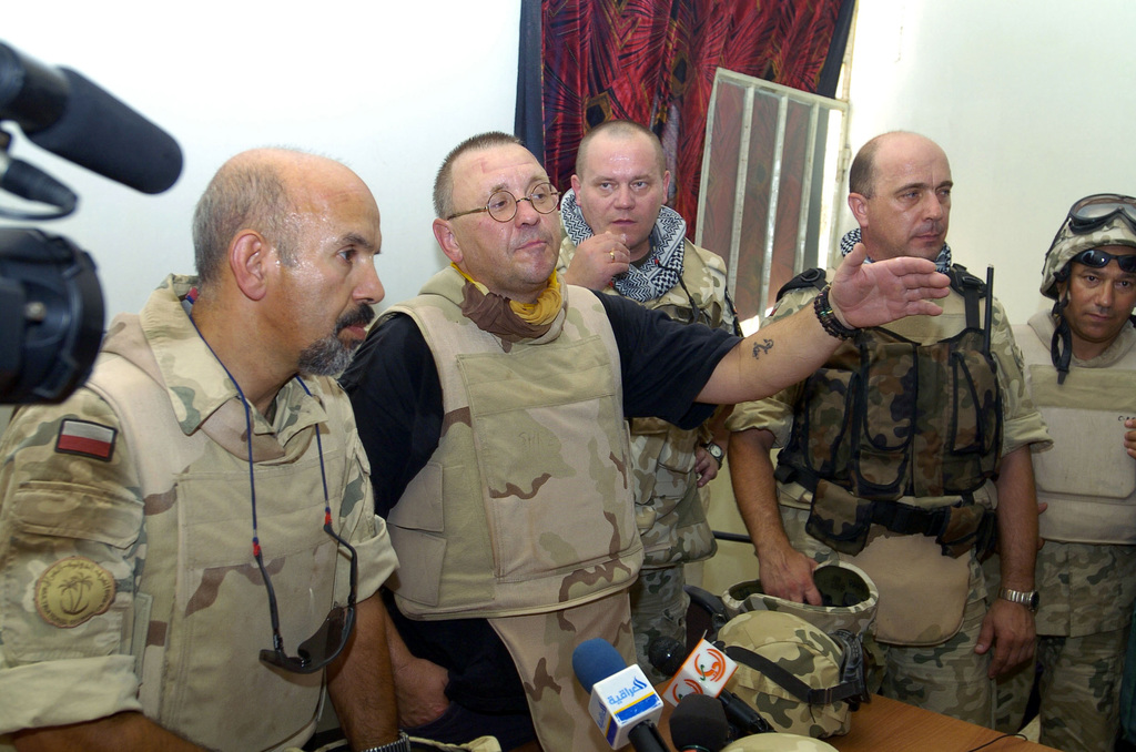 Mr. Jurek Owsiak (center), the chairman of Polish Charity Foundation, and Soldiers from the Polish Military CIMIC (Civilian Military Corporation) speak to the Women and Childrens'Rights Center during a media confrence on June 26, 2005 in Camp Charlie, Iraq.(U.S. Army photo by SGT. Arthur Hamilton) (Released)
