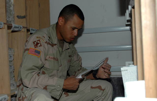 SGT. Jose A. Parrilla, lithographer, Production Platoon, 175th Engineer Company, 20th Engineer Brigade, Fort Bragg, N.C., stocks unclassified maps on the shelves at the 175th headquarters June 28, 2005 at Camp Victory, Iraq.  (U.S. Army photo by SPC. Jeremy D. Crisp.)