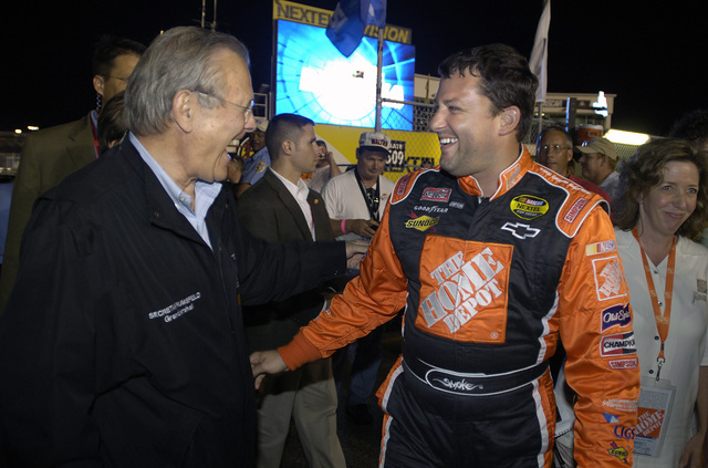 The Honorable Donald H. Rumsfeld, left, U.S. Secretary of Defense, shares a laugh with National Association of Stock Car Auto Racing (NASCAR) Pepsi 400 Race winner Tony Stewart at the Daytona International Speedway, Fla., on July 2, 2005. Sec. Rumsfeld, the event's Grand Marshall, announced the official beginning of the race. (DoD photo by TECH. SGT. Cherie A. Thurlby) (Released)