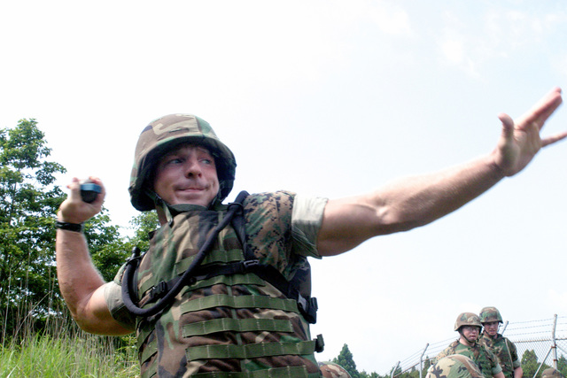US Marine Corps (USMC) Lance Corporal (LCPL) Kocher, Infantry Rifleman, Echo (E) Company (CO), 2nd Battalion (BN), 25 Marines (MAR), gets ready to throw an M69 practice hand grenade at Grenade Range Camp Fuji, Japan during exercise Fuji Incremental Training Program (FITP) 2004