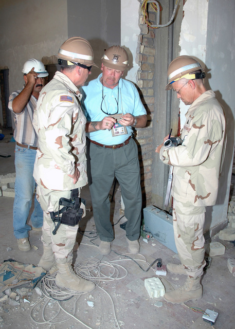 US Army Corps of Engineers (USACE) Officials conduct an onsite inspection at the Al Hayat Residences located in the International Zone (IZ) in Baghdad, Iraq. This US Army Corps of Engineers (USACE) project, will house Iraqi Government Officials and their families. Taken during Operation IRAQI FREEDOM. Pictured foreground left-to-right: US Army (USA) Command Sergeant Major (CSM) Richard Grab, assigned to the Gulf Region Central (GRC); Mr. Dennis Graham, USACE Project Manager; and Mr. Norris Jones, GRC, Public Affairs Officer (PAO)