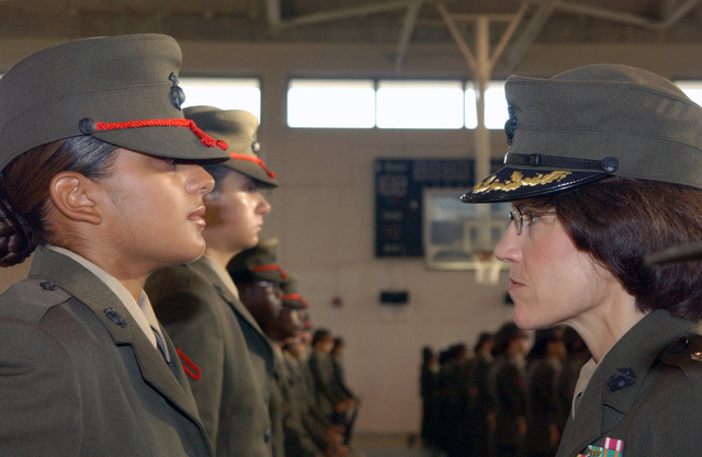 US Marine Corps (USMC) Lieutenant Colonel (LTC) Cynthia J. Valentin, Commanding Officer (CO), Fourth Recruit Training Battalion, speaks with Recruit Camacho, Platoon (PLT) 4020 Oscar Company (O CO), during the Battalion Commander's Inspection aboard Marine Corps Recruit Depot (MCRD) Parris Island, South Carolina (SC). Recruit Camacho is one of the top ten-percent of O CO and will be meritoriously promoted to Private First Class (PFC)