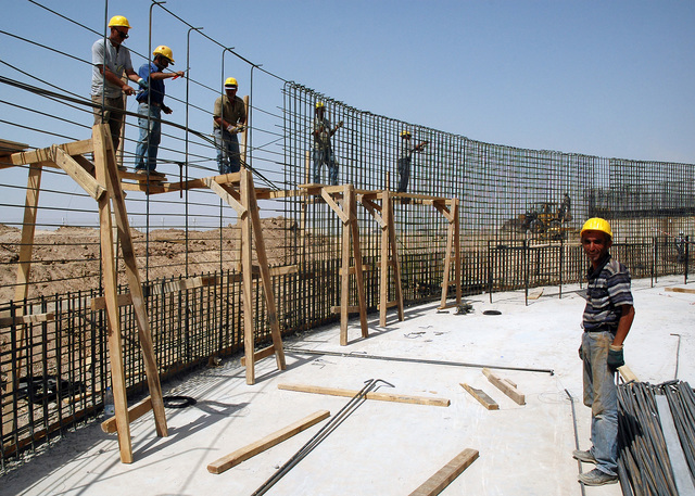Iraqi civilian construction workers build a wastewater treatment facility at Logistical Support Area (LSA) Anaconda, Balad Air Base (AB), Salah Ad Din Province, Iraq (IRQ), during Operation IRAQI FREEDOM