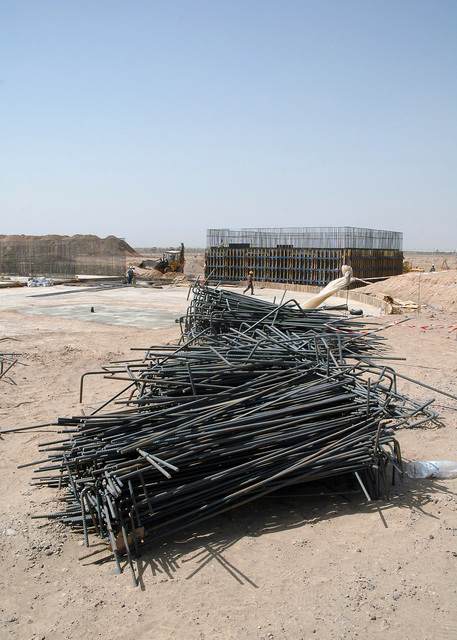 Several piles of pre-bent steel rebar wait placement as part of the construction of a waste water treatment facility being built by Iraqi civilian construction workers at Logistical Support Area (LSA) Anaconda, Balad Air Base (AB), Salah Ad Din Province, Iraq (IRQ), during Operation IRAQI FREEDOM