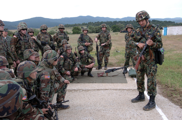 U.S. Army 1ST LT. Petko Tsanev, Bulgarian Army instructs Soldiers from 1ST Squadron, 1ST Cavalry on the proper use of the AK-47 during joint small arms weapons training at Nova Selo Training Area, Bulgaria. (U.S. Army PHOTO by SGT. Kevin S. Abel) (Released)