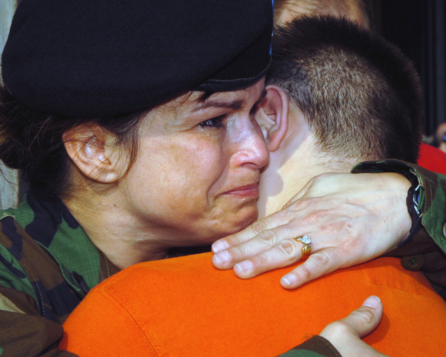 Michigan Army National Guard (MIARNG) Sergeant (SGT) Rita Ferguson, hugs her son goodbye as she deploys with the 238th Combat Support Aviation Battalion (CSAB). (A3596)