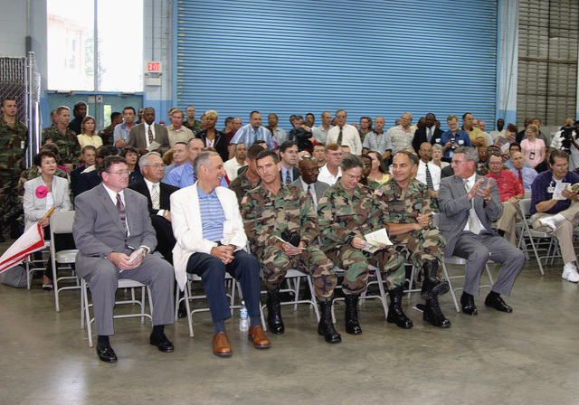 Three General Dynamics contractor dignitaries (in civilian clothes) and three uniformed US Army (USA) general officers sit in the front row during the grand opening celebration of the new Joint Network Node (JNN) Network Training Facility (JNNTF), at the General Dynamics C4 Systems Resident School, in Brant Hall, Fort Gordon, Georgia (GA). The three USA general officers are: Brigadier General (BGEN) Randy Strong (left), the incoming Commanding General (CG), US Army Signal Center & Fort Gordon (USASC & FG); Major General (MGEN) Janet Hicks (center), the outgoing CG, USASC & FG; and Lieutenant General (LGEN) Steven W. Boutelle (right), USA CHIEF Information Officer (G-6). The JNNTF is...