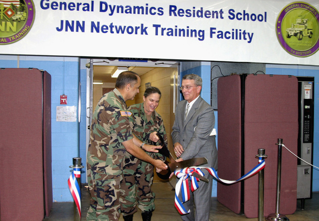 U.S. Army MAJ. GEN. Jan Hick (center), Commander, Fort Gordon, Ga., and LT. GEN. Steven W. Boutelle, U.S. Army CHIEF Information Officer, cut the ribbon at the ribbon cutting ceremony for the Joint Network Node Training Facility at Fort Gordon on July 14, 2005.  (U.S. Army photo by Jimmy Buffington) (Released)