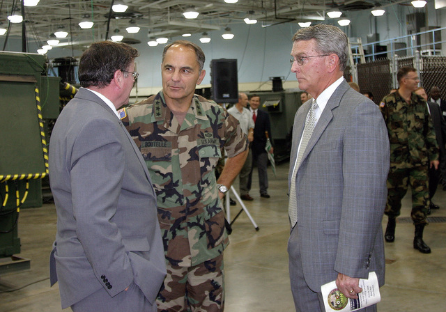 US Army (USA) Lieutenant General (LGEN) Steven W. Boutelle (center), USA CHIEF Information Officer (G-6), speaks with two official General Dynamics contractor dignitaries prior to the start of the grand opening celebration of the new Joint Network Node (JNN) Network Training Facility (JNNTF), at the General Dynamics C4 Systems Resident School, in Brant Hall, Fort Gordon, Georgia (GA). The JNNTF is designed to prepare USA Signal Corps Soldiers for the next generation of battlefield communications to deliver integrated voice, video, and data to battalion level units using commercial, off-the-shelf technology and software