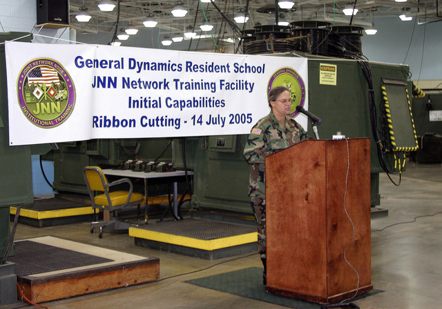 US Army (USA) Major General (MGEN) Janet Hicks, outgoing Commanding General (CG), US Army Signal Center & Fort Gordon (USASC & FG) speaks to the audience during the grand opening celebration of the new Joint Network Node (JNN) Network Training Facility (JNNTF), at the General Dynamics C4 Systems Resident School, in Brant Hall, Fort Gordon, Georgia (GA). The JNNTF is designed to prepare USA Signal Corps Soldiers for the next generation of battlefield communications to deliver integrated voice, video, and data to battalion level units using commercial, off-the-shelf technology and software