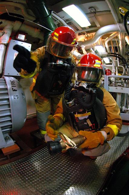 Aircraft Carrier Engine Room: US Navy Fireman Apprentice Jennifer L. Anderson Studies