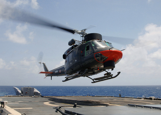 A Peruvian Navy Agusta AB 212 helicopter lands aboard the US Navy (USN) Ticonderoga Class: Guided Missile Cruiser (Aegis), USS THOMAS S. GATES (CG 51), during helicopter cross deck training conducted during Exercise UNITAS 46-05. The Exercise is a Southern Command sponsored Exercise with the objective of increasing interoperability and fostering cooperation among naval forces in the region