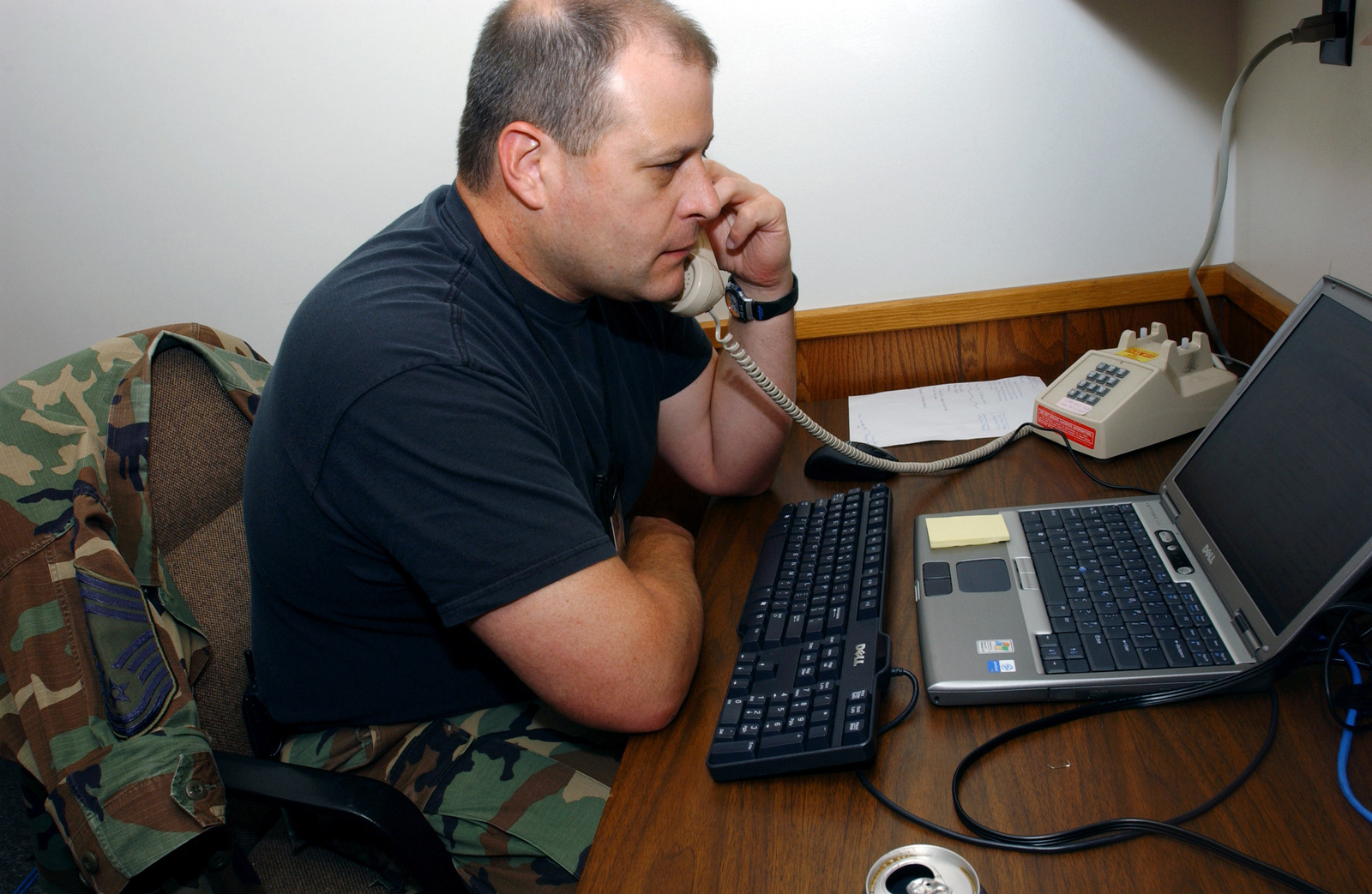 North Carolina Air National Guard (NCANG) CHIEF MASTER Sergeant (CMSGT) Richie Stiller, CHIEF, 145th Communications Flight (CF), 145th Airlift Wing (AW), Charlotte, North Carolina (NC), relays information back home by phone while participating in Patriot Exercise 2005. This annual war-fighting capabilities exercise is the largest held in the United States and involves US Air Force (USAF) and US Army (USA) Active, Reserve, and Guard units, as well as Canadian, United Kingdom, and Dutch military units