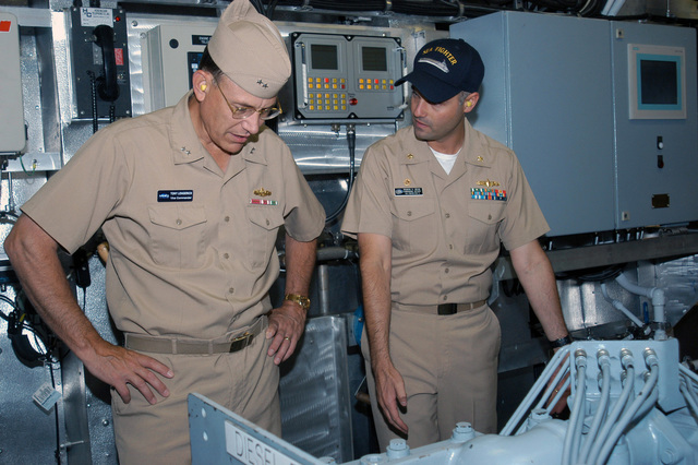 Onboard the US Navys (USN) newest ship, the USS SEA FIGHTER (FSF 1), USN Rear Admiral (RADM) Anthony Lengerich (left), Vice-Commander, Naval Sea Systems Command (NAVSEA), and the ships Commander, USN Lieutenant Commander (LCDR) Brandon S. Bryan, discuss the operation of the ships propulsion diesel engines. The SEA FIGHTER will be used to evaluate the hydordynamic performance, structural behavior, mission flexibility and propulsion systems of high-speed vessels, as well as test a variety of technologies, which will allow the Navy to operate more effectively in Littoral or near-shore waters