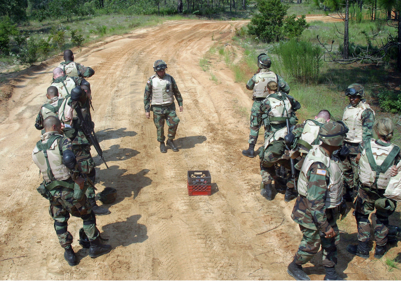 US Army (USA) Soldiers, wearing protective body armor and gear, stand in line to deposit empty 5.56 mm M16A2 rifle cartridge clips after participating a live-fire training exercise conducted at Fort Gordon, Georgia (GA)