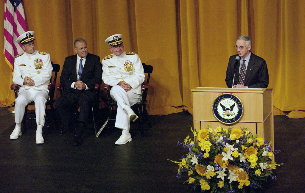 Secretary of the Navy Gordon England, gives his address at the CHIEF of Naval Operations change of command ceremony on July 22, 2005, as The Honorable Donald H. Rumsfeld (center), Secretary of Defense Adm. Mike Mullen (left) and Adm. Vern Clark look on. Adm. Mike Mullen relieved Adm. Vern Clark as CHIEF of Naval Operations (CNO) during a late-morning ceremony at the U.S. Naval Academy.  (DoD photo by TECH. SGT. Kevin J. Gruenwald) (Released)