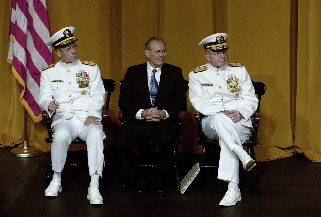 The Honorable Donald H. Rumsfeld (center), Secretary of Defense Adm. Mike Mullen (left) and Adm. Vern Clark listen to the Secretary of the Navy Gordon England addressing the CHIEF of Naval Operations change of command ceremony July 22, 2005. Adm. Mike Mullen relieved Adm. Vern Clark as CHIEF of Naval Operations (CNO) during a late-morning ceremony at the U.S. Naval Academy.   (DoD photo by TECH. SGT. Kevin J. Gruenwald) (Released)