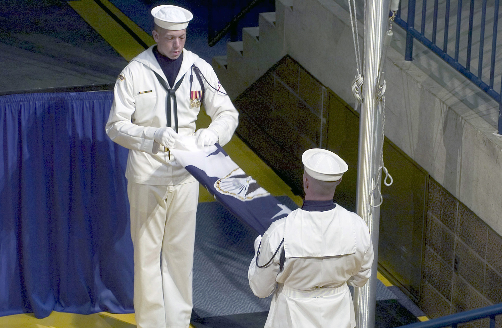 US Navy (USN) Sailors assigned to the Ceremonial Honor Guard Team fold the retired Flag for CHIEF of Naval Operations (CNO) Admiral (ADM) Vern Clark (Retired), during a late-morning ceremony at the US Naval Academy, at Annapolis, Maryland