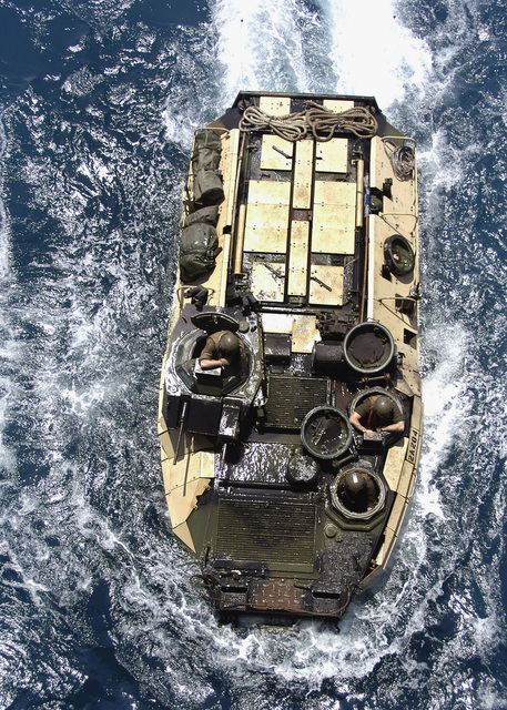 Overhead view of a US Marine Corps (USMC) 26th Marine Expeditionary Unit (MEU) AAV7A1 (Assault Amphibian Vehicle) as it maneuvers into position to enter the well deck of an amphibious assault ship currently conducting Maritime Security Operations in the Persian Gulf. The AAV7A1 is an armored assault amphibious full-tracked landing vehicle. The vehicle carries troops in water operations from ship to shore, through rough water and surf zone. It also carries troops to inland objectives after going ashore