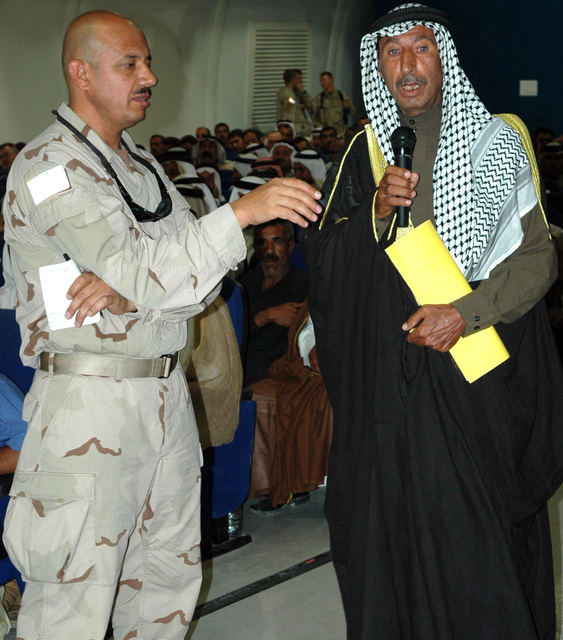 An Iraqi Sheik expresses his concerns during the Qayyarah West Regional Security Council Meeting held July 26, 2005, at Forward Operating Base Q-West.  (U.S. Army photo by SPC. Jeremy D. Crisp) (Released)