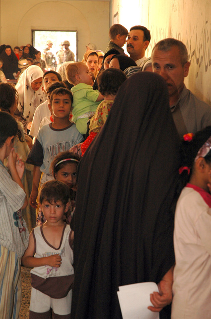 Iraqi families line up at a schoolhouse for a medical screening given by U.S. Soldiers with the 1ST Stryker Brigade Combat Team, 25th Infantry Division, Fort Lewis, Wash., July 28, 2005, in Mosul, Iraq.  (U.S. Army photo by SPC. Jeremy D. Crisp) (Released)
