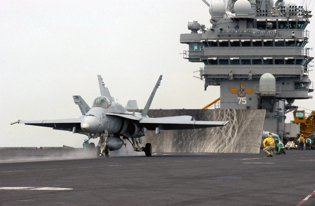 A US Navy (USN) F/A-18C Hornet, Strike Fighter Squadron 106 (VFA-106), Gladiators, Naval Air Station (NAS) Oceana, Virginia (VA), launches from the flight deck aboard the USN Nimitz Class Aircraft Carrier USS HARRY S. TRUMAN (CVN 75). The TRUMAN is currently conducting carrier qualifications and sustainment operations off of the East Coast