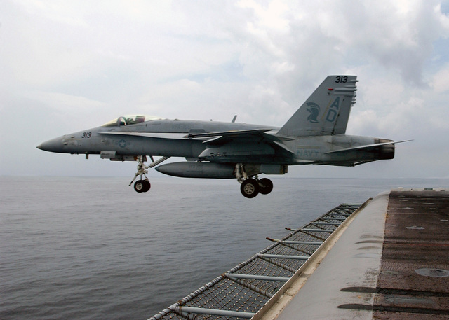 A US Navy (USN) F/A-18C Hornet Strike Fighter Squadron 106 (VFA-106), Gladiators, Naval Air Station (NAS) Oceana, Virginia (VA), clears the flight deck after launching from the bow of the USN Nimitz Class Aircraft Carrier USS HARRY S. TRUMAN (CVN 75). The TRUMAN is currently conducting carrier qualifications off the East Coast