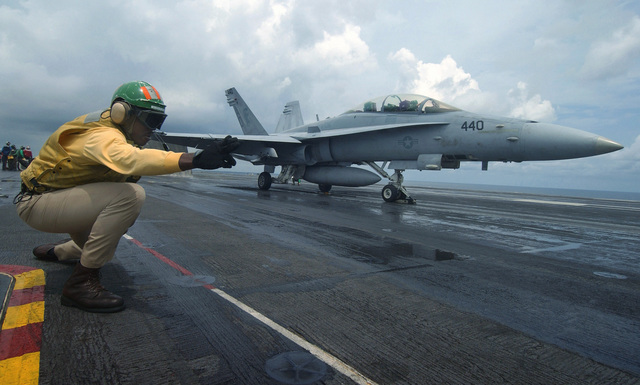 US Navy (USN) Lieutenant (LT) Lamar Bradley, Shooter, Air Department, gives the signal to launch a USN F/A-18D Hornet fighter, Strike Fighter Squadron 106 (VFA-106), Gladiators, Naval Air Station (NAS) Oceana, Virginia (VA), from the flight deck of the USN Nimitz Class Aircraft Carrier USS HARRY S. TRUMAN (CVN 75). The TRUMAN is currently conducting carrier qualifications off the East Coast