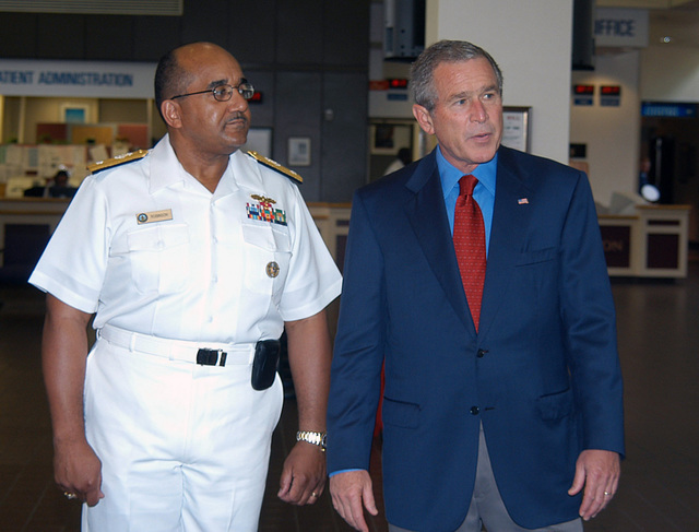 US President George W. Bush (right) and US Navy (USN) Rear Admiral (RADM) (upper half) Adam Robinson, Commander, National Naval Medical Center (NNMC), walk together as they exit the hospital following the president's successful annual physical. Known as the President's Hospital, the NNMC in Bethesda, Maryland (MD), is the historical site of all presidential physicals since 1942