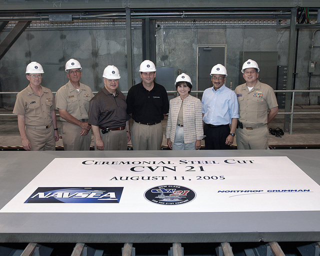The participants for the cutting of the first piece of steel for CVN 78, the first aircraft carrier of the CVN 21 program, pose during a ceremony at Northrop Grumman Newport News shipyard. From left to right: US Navy (USN) Rear Admiral (RDML) (lower half) H. Denby Starling II, Commander Naval Air Force, US Atlantic Fleet; USN RDML (lower half) David Architzel, Program Executive Officer for Aircraft Carriers; Joe S. Frank, Mayor of Newport News; Mike Petters, President, Northrop Grumman Newport News; Representative Jo Ann Davis (R-VA, 1ST District); Representative Robert C. Scott (D-VA, 3rd District); USN Captain (CAPT) Michael E. McMahon, Commanding Officer, Supervisor of Shipbuilding,...